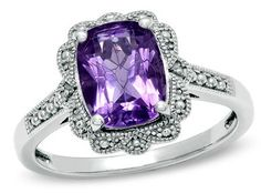 amethyst ring...just imagine the amethyst and diamond reversed...it it hard to find a diamond ring with amethyst halo!