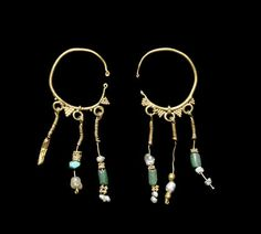 A pair of Parthian gold and green glass earrings  Iran, circa 3rd Century A.D.