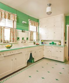 the pretty tile floor dates to the 1930 renovation; cabinets are likely original. Nancy Conescu added the arched doors. Glossy green Marlite on the walls is ca. { Love this vintage kitchen! Kitchen Retro, 1930s Kitchen, Art Deco Kitchen, Vintage Kitchen Decor, Old Kitchen, Retro Home Decor, Vintage Decor, Kitchen Ideas, Green Kitchen