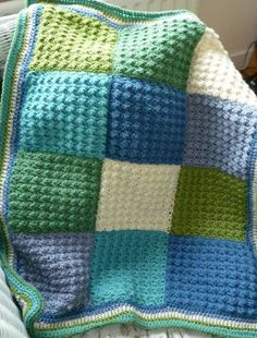 Uses Lion Brand  9 Patch Baby Throw and adds a 3 color border