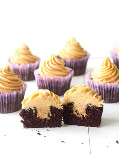 ... chocolate cupcakes with a fluffy peanut butter frosting and a secret stash of peanut butter inside ...