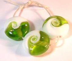Lime and White Swirl -  Handmade Lampwork Glass Beads. $15.00, via Etsy.