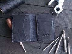Minimalist wallet Leather wallet Personalized wallet Small wallet with great features. Has 4 compartments for 10 cards and compartment for cash. The wallet is 100% handmade. The seam is made by hand using very strong waxed thread with a diameter of 1 mm. This wallet used leather vegetable tanned made Italy. The color is black.  Personalization for free. To make this purse unique and unique by adding personalization. You can make a name, surname or just initials. -To write in the notes…