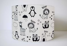 A stunning monochrome animal lampshade. With lions, penguins, pandas, giraffes in black set on a white background. A lovely lampshade for a monochrome kids room or for an animal themed bedroom. Bedroom Themes, Nursery Themes, White Lamp Shade, Lamp Shades, Animal Lamp, Panda Nursery, Monochrome Nursery, Adventure Nursery, Floor Standing Lamps