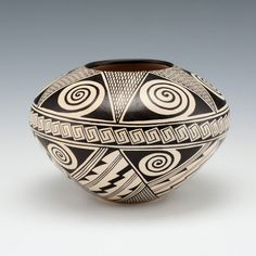 """This jar by Rainy Naha is based on the classic """"Awatovi Star"""" pattern revived by her mother, Helen Naha. The bowl has the Awatovi star painted…"""