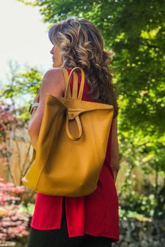 We LOVE this versatile bag! Wear as a backpack or if more room is needed secure strap behind to carry as a tote. The wide bottom makes for a roomy bag to carry a few files or books, iPad, smaller water bottle. The outside back zip pocket fits a passport perfectly. Your items are secure with the zip top. Available in several colors. #backpackforwomen #fashionbackpackspurse #fashionbackpacksbags #fashionbackpack #leatherhandbags #purse #handbags #totehandbags #workbag #leathertotebag