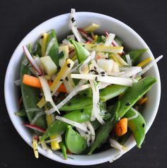 Snap Pea Salad: Crisp jicama, savory squash and bitter radishes are cut into tiny matchsticks and tossed with sweat peaches, snap peas, cilantro and dill. A spicy lime ginger vinaigrette is the perfect pairing to dress this sophisticated salad. #MeatlessMonday