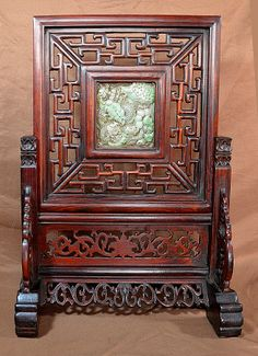 Huanghuali Screen with Jadeite Plaque  A Chinese carved wood and jadeite table screen, 18th century.