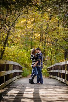 pretty engagement pictures at starved rock on wooden bridge