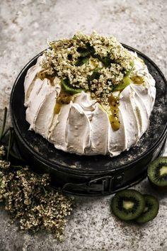 pavlova with kiwi lime curd and elderfower cream.
