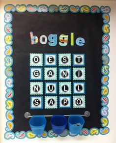 boggle with printables : I printed up the following letters on card stock, cut them out, and laminated them. I printed 3 of each letter since a letter may appear more than once in a game of boggle. The extras are being kept in the blue cups.