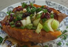 Enjoy this grown-up, vegan version of a gourmet baked potato from Vegan on the Go-Go.    Ingredients  1 large sweet potato, baked for about 40 minutes until tender  2-4 Tbs. hummus  1 medium stalk celery, chopped  2 Tbs. chopped scallions  1 Tbs. dried cranberries  1 Tbs. chopped parsley    Orange-Balsamic Dressing  1 Tbs. orange juice  1 tsp. balsamic vinegar  1 tsp. olive oil    www.facebook.com/healthyharmony