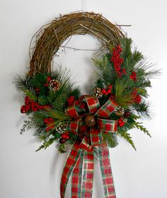 The Country style Christmas Wreath is simple and Beautiful! It would be perfect for a cabin or house in the woods!    Its a grapevine base