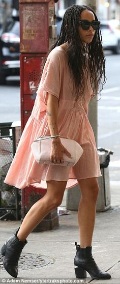 Flawless star: The 27-year-old paired the thigh-grazing blush hued frock with black boots while on a stroll with a friend