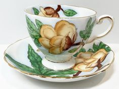 Botanically inspired bone china teacups and saucers are graceful, delightful, reminders of spring. This elegant set was manufactured by Tuscan Fine Bone China of England. Tuscan created a series of teacups with Hawaiian flowers. This is the Wood Rose, pattern C9508. Its backstamp was
