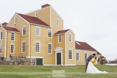 Love this shot of a bride and groom outside of the historic yellow barn at the Wentworth-Coolidge Mansion in Portsmouth, NH.  This lakeside New England wedding venue is secluded, rustic, and lovely!