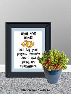 """This printable sign features a Nemo-like fish and blue and white striped border. The words read, """"Wash you hands and say your prayers because Jesus and germs are everywhere."""""""