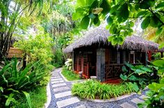 Tropical Hut in the Maldives. The pavers set in mexican pebbles as a pathway. Tropical Garden Design, Garden Landscape Design, Tropical Houses, Tropical Gardens, Bungalows, Bali Huts, Bali Style Home, Luxury Tree Houses, Hut House
