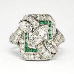 This exceptional 1930s Art Deco marquise, antique cut diamond and calibre cut natural emerald ring is a show stopper! No one will have this