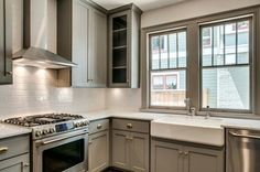 clean and simple, neutral kitchen redo idea. subway tiles, apron sink, gray painted cabinets, brushed nickel * grey and white :: the perfect backdrop to colorful food and flowers