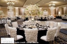 Gorgeous white wedding with amazing chair covers and hanging crystals paired with tall centerpieces. @janaeshields #reception Location Thomas Fogarty Winery