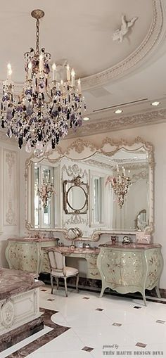 This is a Baroque powder room/bathroom. It is a very sophisticated room, and the main color is golds and creams with a little bit of a color splash on the chandelier and the vanity. Decor, Luxury, Interior, Beautiful Bathrooms, French Decor, Home Decor, Chandelier, Luxury Rooms, Luxury Homes