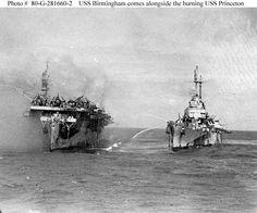 USS Birmingham comes alongside the burning USS Princeton, October 1944.