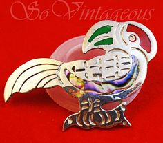 SoVintageous is offering this fabulous vintage sterling silver Parrot brooch, handmade in Mexico and inlaid with abalone and red and green enamel.  This adorable brooch is beautifully etched and has a