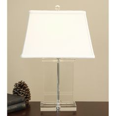 Illuminate a shadowy corner while adding elegance to a library or living room with this modern crystal table lamp. The transparent crystal base and white shade won't clash with any other color scheme or upholstery pattern in the room.