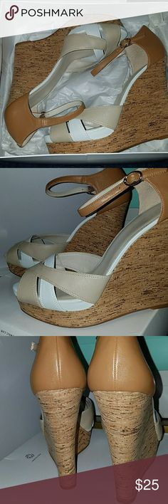 Nine west tan and white wedges in original box Almost new Nine West wedges only worn once.  No scuff or dirt marks at all. Shoes still have original packaging and cardboard shaping inserts. In excellent condition perfect for spring. Nine West Shoes Wedges