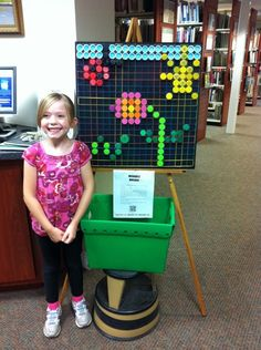 Great passive program: a board with strings in a grid, paired with a bucket below full of plastic bottle caps!  It's like a very low-tech litebrite... a fun way to recycle and to make beautiful art :)  From the Hillsdale (NJ) Public Library.