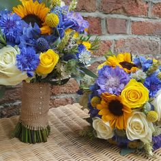 Sunflowers and wheat with cornflowers