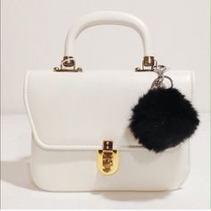 Black Fur Puff Ball Keychain w/ Pearl New and never been used faux fur ball with faux pearl. Very cute and the silver hardware itself looks nice and sturdy. Grab this cutie while it's hot! (Note: Bag in photo not included)  Accessories Key & Card Holders