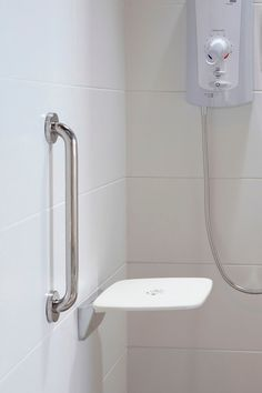 Fesselnd Accessories, : Simple Bathroom With Metal Shower Grab Bar And White Plastic  Wall Shelf Also