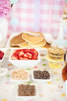 Breakfast Birthday party for a young child - Pancake and waffle topping buffet and invite guests to wear their pjs! Great idea for a baby shower as well!