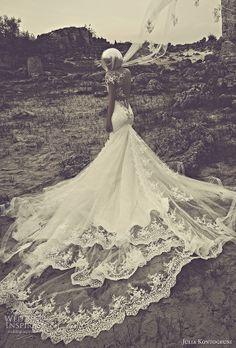 Love Julia Kontogruni's mermaid wedding dress illusion with an exaggerated back train view.     #TOMSwedding