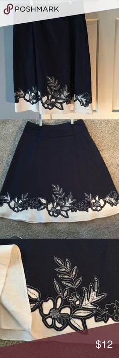 Susan Bristol navy and white fully lined skirt Cotton and linen fully lined skirt.  Picture 3 shows the detail.  The bottom white is linen with the beautiful floral details.  The touch of silver accent in the skirt makes it versatile to dress up or down.  Perfect for that summer open house or casual party. susan bristol Skirts
