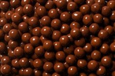 This is a bag of brown candies. These mini candy pieces are inch; made by Sweet Works Sixlets Candy, Candy Companies, Sweet Words, Candy Buffet, Nut Free, Special Gifts, Fruit, Eat, Brown