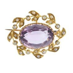 An early 20th century 15ct gold amethyst and split pearl brooch.