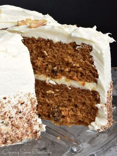 Fabulous Carrot Cake Recipe - It's moist, perfectly-spiced, made with fresh carrots, pineapple, and raisins with the traditional cream cheese frosting.