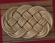 How fabulous is this rug? Nautical Welcome Mat Large Braided Rope Door Mat, Sailor Ocean Plait Celtic Knot Rug. via Etsy.