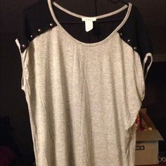 Gray top with black sheer shoulders Super cute too! Gray top with black sheer shoulders with silver studs on shoulders! Luxe Tops Blouses