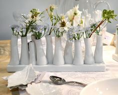 Spring is here - love multi bud vases.