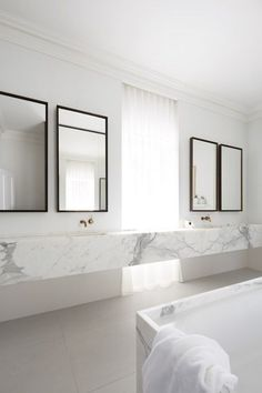 Love the marble on this double vanity.