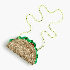 "Our creative crewcuts designers dream up crazy-fun shapes (like this too-cute taco) and cover them in custom glitter. The result? Bags so cool that even grown-ups are buying them. 4 3/8""H x 7""W x 1""D.20"" handle drop.Glitter-coated cotton.Zip closure.Import.Select stores."