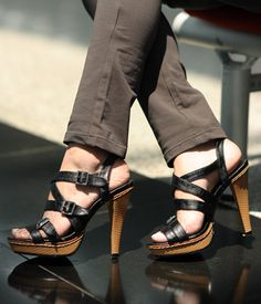 A sky-high stacked heel and platform sole lift these sleek strappy sandals styled with faux leather straps.US$45.00