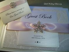 Luxury Bespoke Snowflake Wedding Guest Book. Various Colour Options for Satin Ribbon. by QuillsWeddingFavours on Etsy QuillsWeddingFavours on Etsy www.quillsweddingstationery.co.uk https://www.facebook.com/pages/Quills-Wedding-