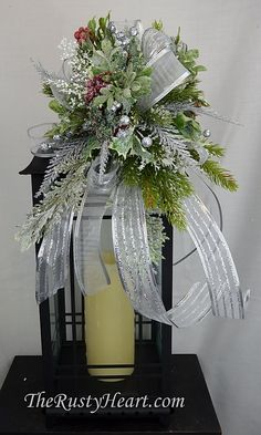 Christmas Lantern Swag by TheRustyHeart on Etsy Fall Lanterns, Christmas Lanterns, Christmas Door Decorations, Christmas Swags, Lanterns Decor, Christmas Crafts, Lantern Centerpieces, Holiday Centerpieces, Christmas Flower Arrangements