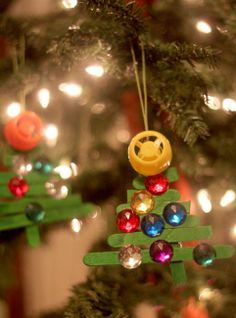 Craft stick Christmas tree craft for the kids to make this year