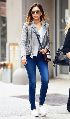 Jessica Alba wears her go-to moto jacket with everything, including this simple jeans, platform sneakers, and tee look